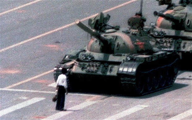 The famous photograph shot during Tiananmen protest when a lone man (popularly know as the 'Tank Man'), tried to stop the column of tanks. Courtesy: The telegraph